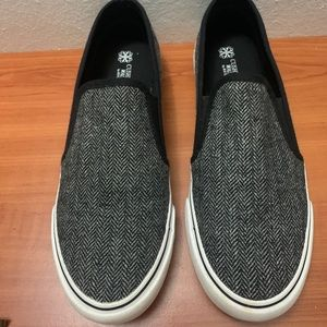 Black and grey cushion slip on vans
